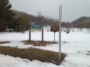 Posts for new MDOT road signs on M-22 seem set to obscure the new signs for the Elberta Dunes South Natural Area.